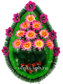 Венок ритуальный на кладбище из искусственных цветов