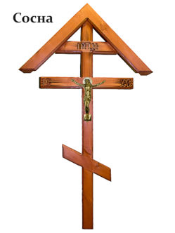 Деревянный крест на кладбище